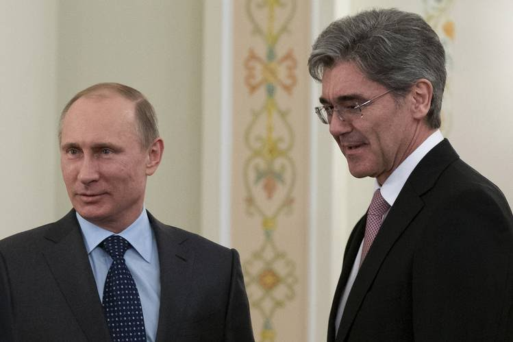 Russian President Vladimir Putin, left, with Siemens CEO Joe Kaeser in March 2014.